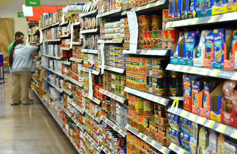 by: VERN UYETAKE - The shelves were nearly full during an Oct. 9 tour of the new Walmart neighborhood market in Lake Oswego.