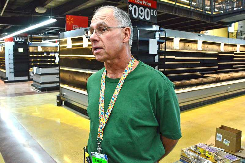 by: VERN UYETAKE - Gregg Leonetti of Lake Oswego is among new employees at the Walmart neighborhood market off Boones Ferry Road. He used to work in telecommunications.