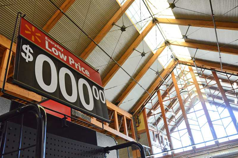 by: VERN UYETAKE - While the conversion from a Wild Oats natural food store to a Walmart grocery required some minor remodeling, the high ceilings and exposed wood remain at the new neighborhood market in Lake Oswego.