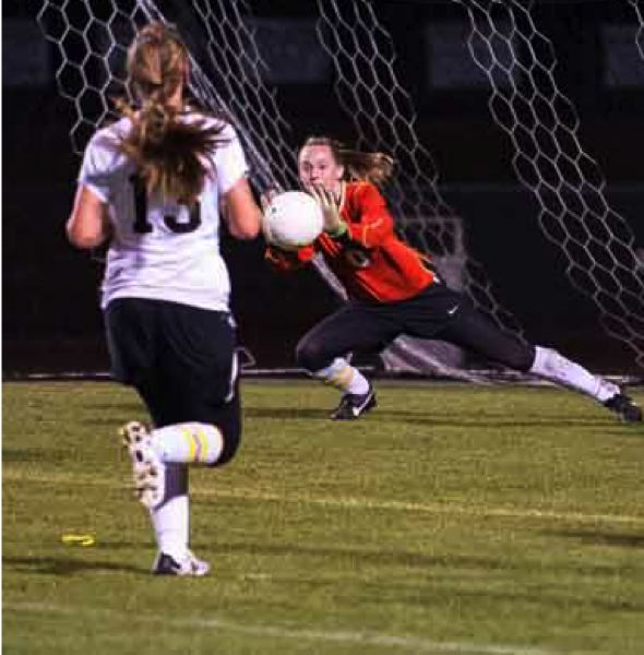 by: JEREMY DUECK - St. Helens' Dana Sukau blocks a shot on goal during last week's match with sixth-ranked Wilsonville. St. Helens lost the match, 2-1.