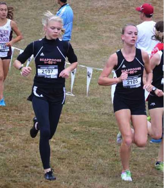 by: JOHN BREWINGTON - Scappoose's Charlie Davidson (left) and Tia Carnahan did well at the huge Adidas XC Classic Saturday at Fernhill Park in Portland. Carnahan finished seventh and Davidson finished ninth overall. The Scappoose girls were second as a team.