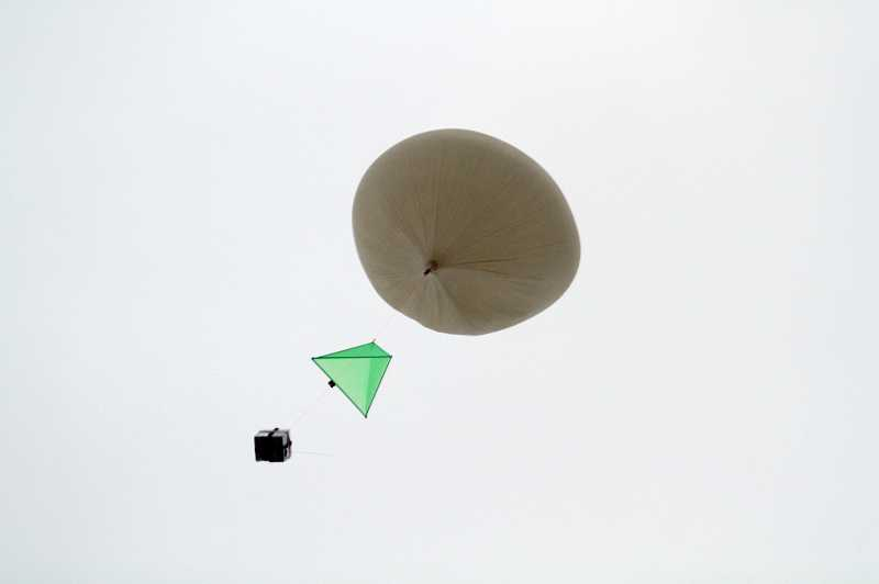 by: JONATHAN HOUSE - The high altitude balloon floats over Tualatin High School, carrying two cameras to take a panoramic view of Earth from the upper atmosphere.