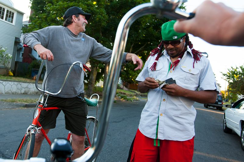 by: TRIBUNE PHOTO: CHRISTOPHER ONSTOTT - Schwinn bikes are the draw for members of club Belligerante in Northeast Portland that attracts a racially diverse crowd. Letter writers say it's time to have a good conversation about racial relations.