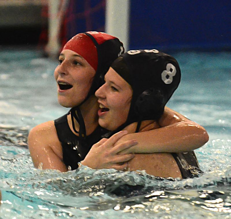 by: VERN UYETAKE - Lake Oswego's Kim Fay and Caitlyn Regan celebrate a narrow 3-2 win against Lakeridge.