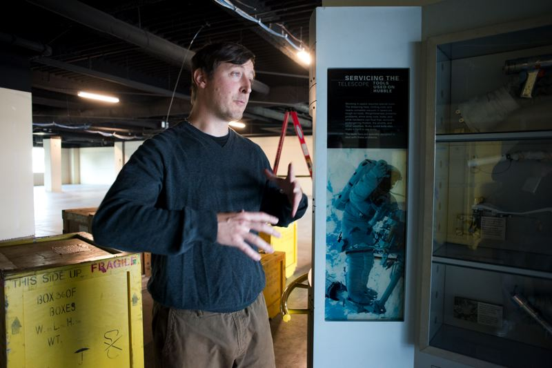 by: TRIBUNE PHOTO: CHASE ALLGOOD - Washington County Museum Curator Adam Mikos stands near a small part of the Hubble Space Telescope exhibit that opens on Nov. 17.