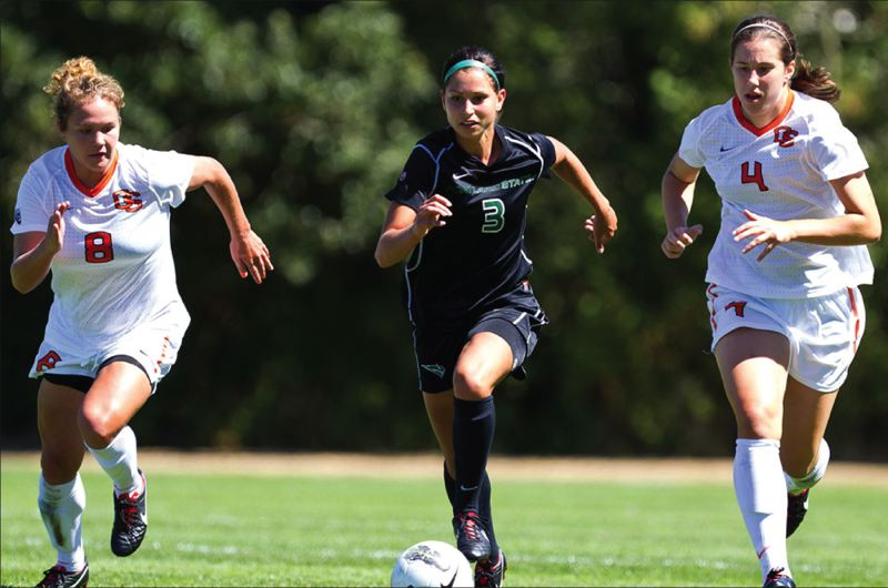by: PHOTO BY LARRY LAWSON - Portland State freshman midfielder Cori Bianchini splits Oregon State defenders Jessica Niewoehner (8) and Erin Uchacz (4) during the teams non-conference match on Aug. 24.