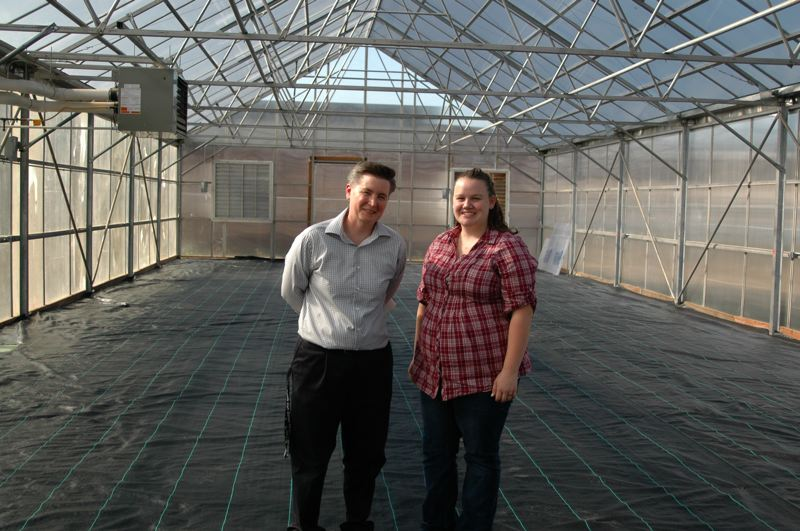 by: PHOTOS BY JEFF SPIEGEL - Estacada High School science teacher Kate Dean and student Riley Stetson stand in the schools new greenhouse. Dean spearheaded the six-year quest for a greenhouse but couldnt have done it without the help of students and volunteers like Stetson.