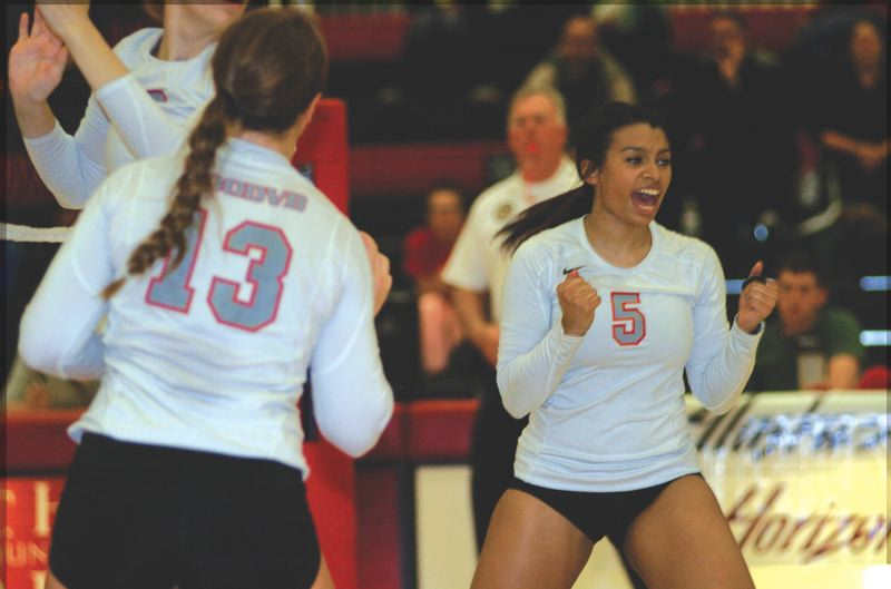 by: THE OUTLOOK: DAVID BALL - Mt. Hood CC setter Alyssa Hall celebrates a point during the Saints three-set sweep over Umpqua on Friday night.