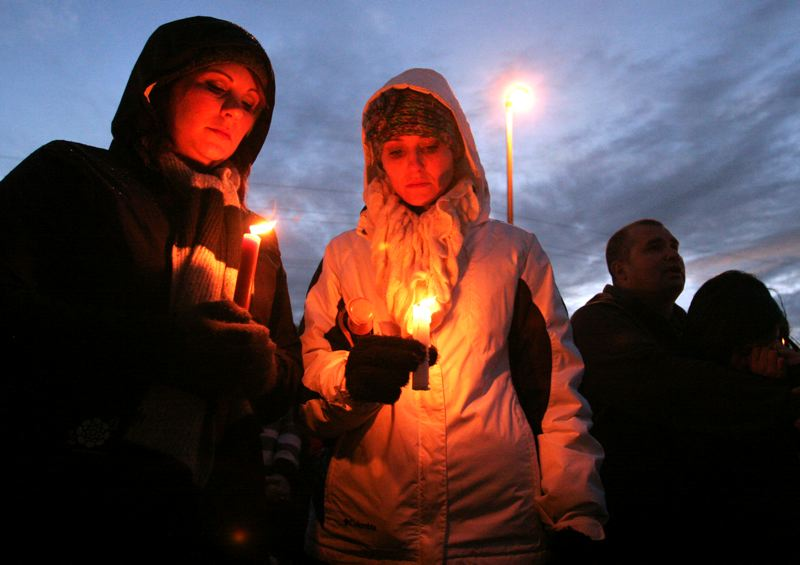 by: OUTLOOK PHOTO/ JIM CLARK - Jennifer Weimer, left, and Amy Knight take part in the Saturday night candlelight vigil for Whitney Heichel. Ballard lives a short distance from the Starbucks where Heichel worked and was a regular customer.