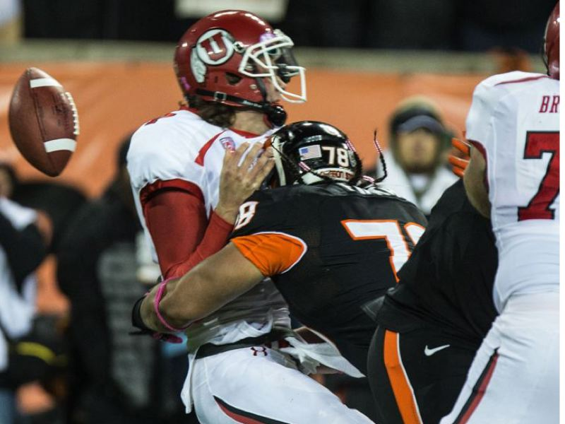 by: TRIBUNE PHOTO: CHRISTOPHER ONSTOTT - Oregon State defensive end Rudolf Fifita sacks Utah quarterback Travis Wilson, causing a fumble, as the Beavers win their sixth game of the season Saturday.