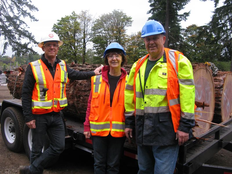 by: PHOTO BY RAYMOND RENDLEMAN - Michael Kiser, public art coordinator for TriMet, stands with artists Pasha and Cate Stinson of Southeast Portland while they pick up their wood in Oak Grove.