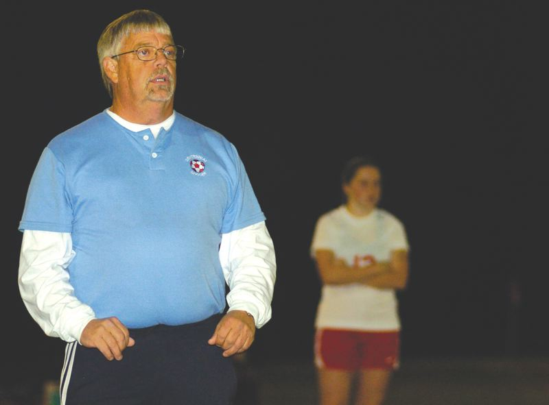by: THE OUTLOOK: DAVID BALL - Centennial girls soccer coach Dick Bertelsen watches last weeks 1-0 loss to Central Catholic. He has spent 30 years with the Eagles program, winning a state title in 2000.