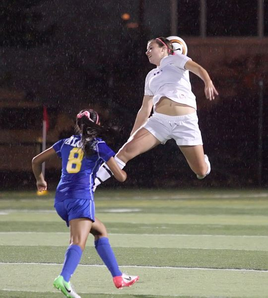 by: MILES VANCE - FLYING HIGH - Sunset's Payten Sonnen flies for a header during her team's 0-0 tie with Aloha on Thursday at Sunset High School.