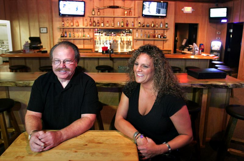 by: OUTLOOK PHOTO: JIM CLARK - OUTLOOK PHOTO: JIM CLARK Tom Ellis, left, is the owner and Kris Lee is the general manager of Midnight Roundup Saloon and Eatery, a new country bar in Gresham.
