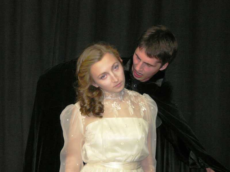 by: SUBMITTED PHOTO: LAURA BARTROFF - Dracula, played by Jeremy Howard, prepares to bite Mina Murray, played by Annie Parham, in Oregon Children's Theatre's Young Professionals Company.