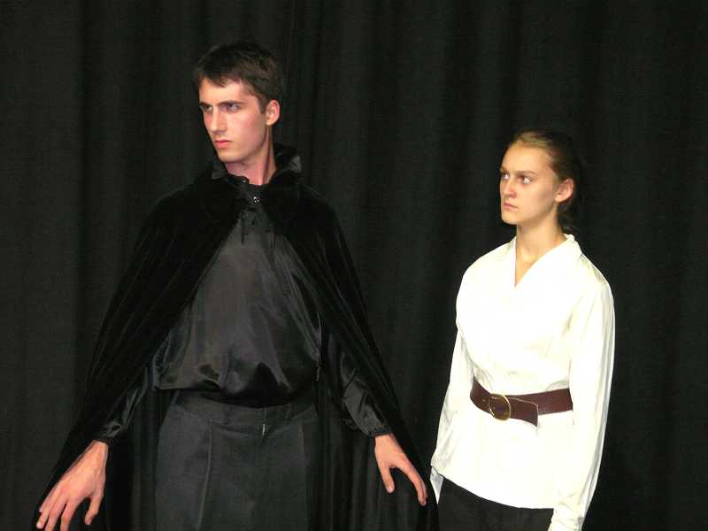 by: SUBMITTED PHOTO: LAURA BARTROFF - Above: Professor Van Helsing, played by Stephanie Roessler of Lakeridge High School, considers how to kill Dracula (Jeremy Howard).