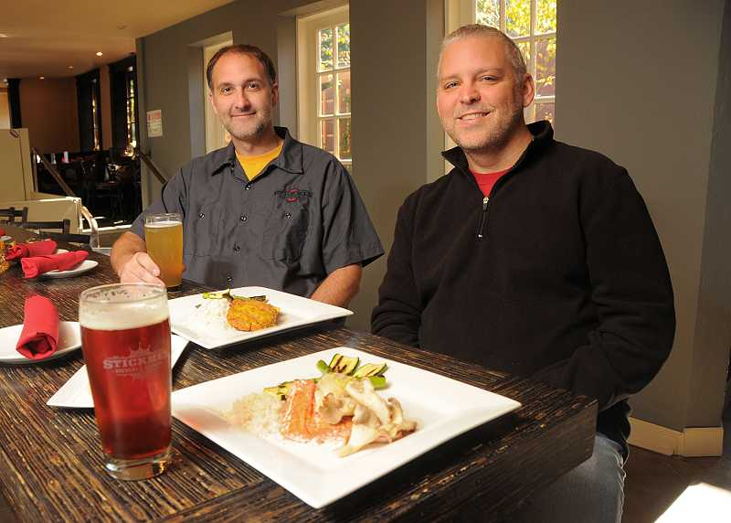 by: REVIEW, TIDINGS PHOTO: VERN UYETAKE - Stickmen Brewery & Skewery owners John Turner  and Tim Schonheit sit down for a pint.
