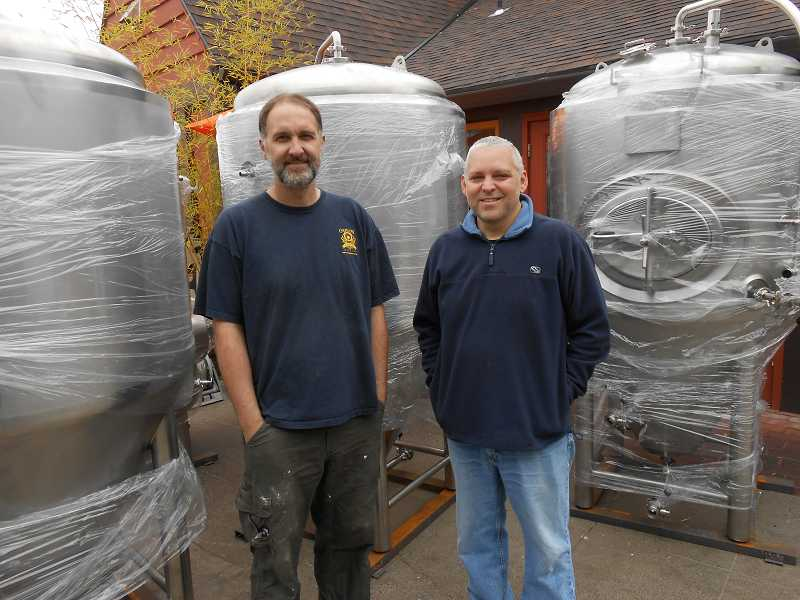 by: REVIEW, TIDINGS PHOTO: CLIFF NEWELL - Turner and Schonheit are eager to greet the delivery of seven huge beer tanks.