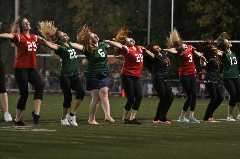 The West Linn High School Debs and Oregon City Jets dance teams performed at the homecoming football game.