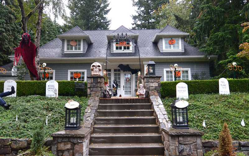 by: VERN UYETAKE - Take a drive down most any street in Lake Oswego and there is no denying people are preparing for Halloween. Pumpkins and jack-o'-lanterns, witches, ghosts, goblins and tombstones are popping up where you least expect to see them, including this house in Lake Oswego. If you are brave enough, drive past this frightful house in the 17000 block of Kelok Road. Halloween is Oct. 31.