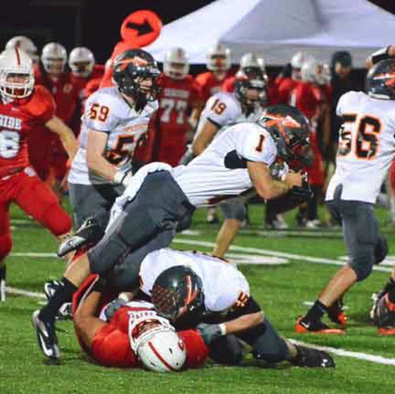 by: JOHN BREWINGTON - Scappoose's Carson Davison found the going tough Friday but still rolled up 146 yard rushing. The Indians host Astoria on Friday.