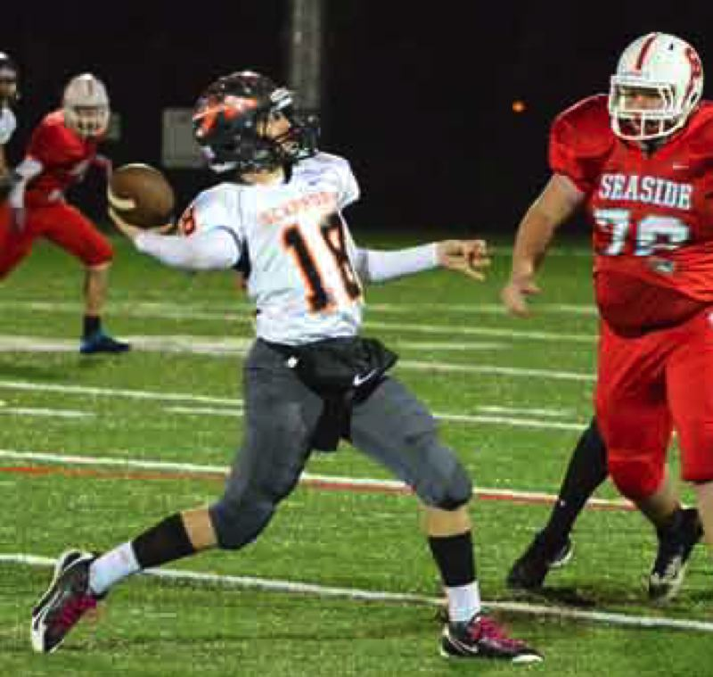 by: JOHN BREWINGTON - Taylor Loss had another good night at quarterback for Scappoose, throwing for three touchdowns.