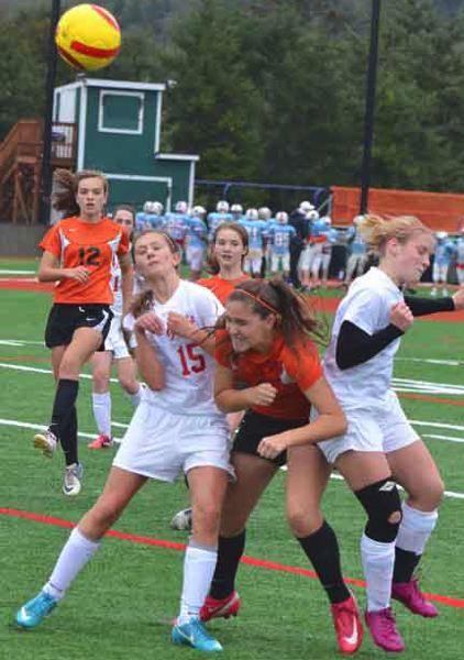 by: JOHN BREWINGTON - Scappoose's Emily Muth jostles with Seaside players during Friday's match.