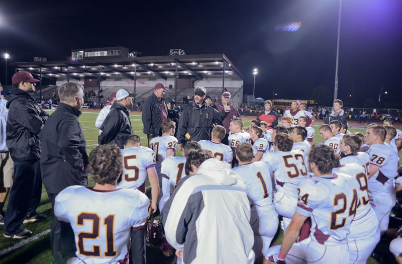 by: CHASE ALLGOOD - Forest Grove football coach Dwight Jensen gives a speech to his team after the Vikings 24-16 defeat of Hillsboro.