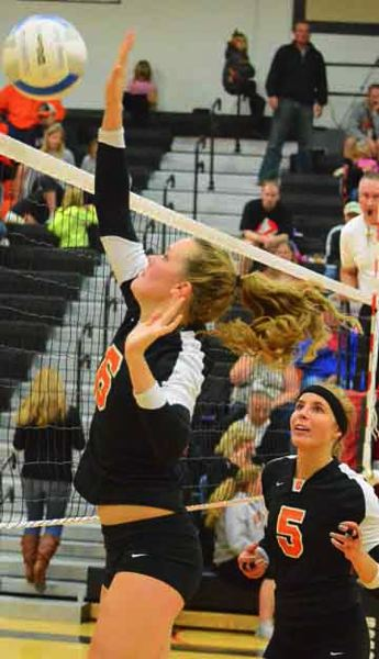 by: JOHN BREWINGTON - Scappoose's Phlycia Haigh goes up for a kill during the Tribe's match with Astoria on Monday. The match was the last of the regular season, and put the Lady Indians in a three-way tie with Astoria and Tillamook.  Playoffs were scheduled for Tuesday in Banks, and Wednesday if needed.