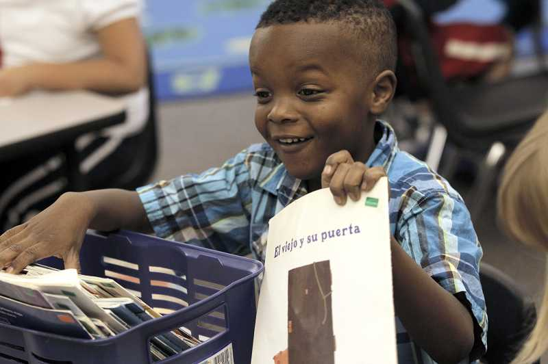 by: JAIME VALDEZ - Metzger kindergartner Yonis Imam shows a classmate a Spanish book he picked out to read in Stephanie Dahlmans kindergarten Duel Language Immersion class. School officials say dual-language classes are beneficial to native and non-native Spanish speakers.