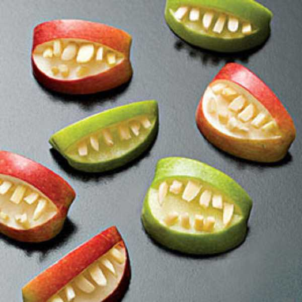 by: SUBMITTED - These ogre teeth, made of apple wedges and almonds, are a fun and festive food to serve for Halloween dinner and parties.