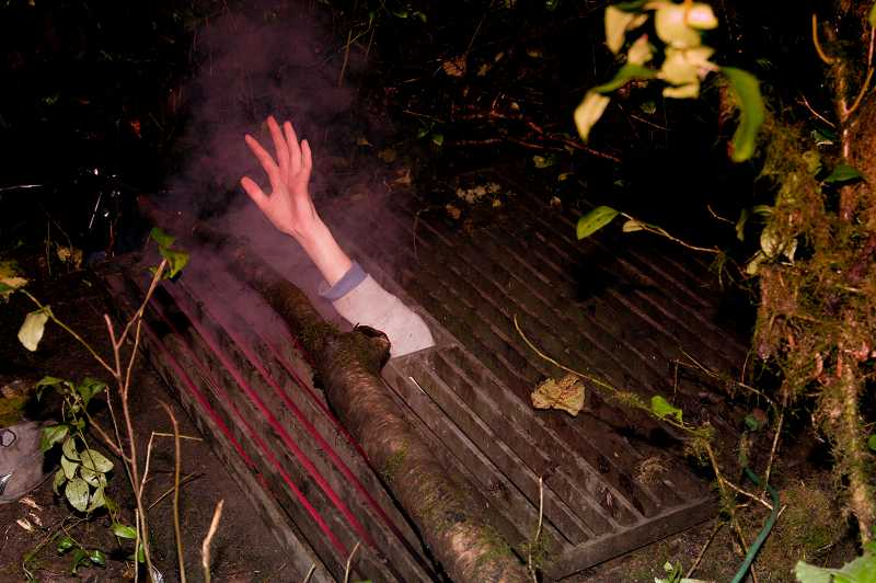 by: SUBMITTED - A hand reaches from the depths of hell at last year's Haunted Trail at Mary S. Young Park.