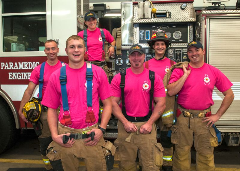 by: SUBMITTED PHOTO BY TVF&R - Tualatin Valley Fire & Rescue firefighters from Station 62 in Aloha go pink in support of women and their families affected by breast cancer.