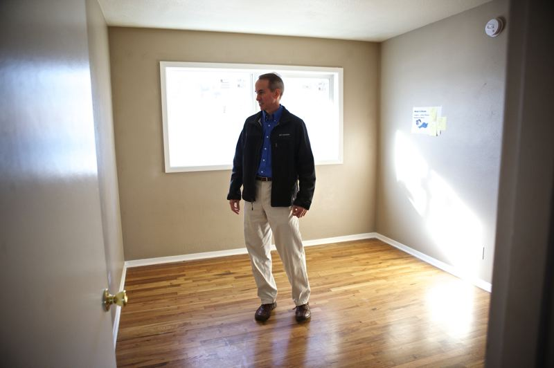 by: JAIME VALDEZ - Beaverton City Councilor Marc San Soucie looks at a bedroom of an apartment renovated for the Boys & Girls Aid Transitional Living Program.