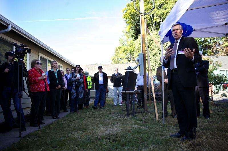 by: JAIME VALDEZ - Boys & Girls Aid President and CEO Michael Balter speaks to attendees of a open house of a new transitional home for youth in Central Beaverton.