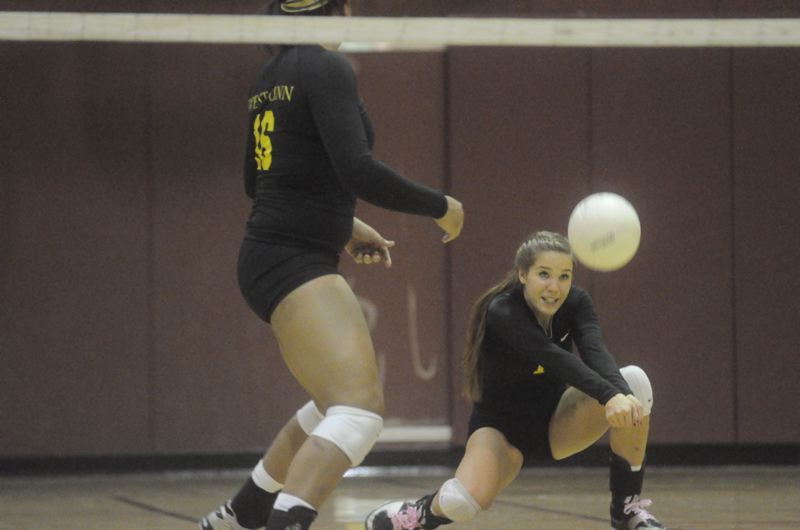 by: MATTHEW SHERMAN - West Linn's Courtney Misner digs a ball during Tuesday's four-set loss to Clackamas played at Rosemont Ridge Middle School.