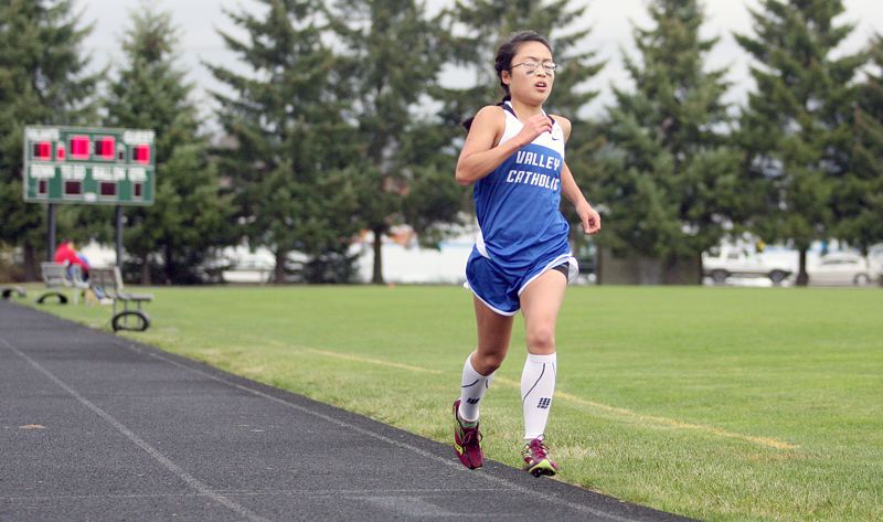 by: MILES VANCE - ALL ALONE - Valley Catholic junior Josephine Chau left the rest of the field far behind to win the girls race at the Valiant Invitational on Friday at Valley Catholic High School.