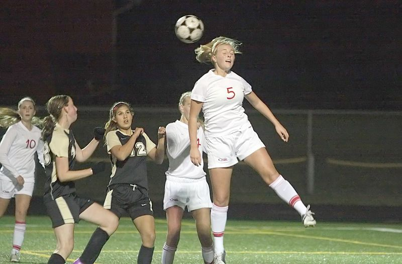 by: MILES VANCE - HEAD GAMES - Westview's Mallory Ashcraft makes a header during her team's 0-0 tie against Southridge at Westview High School on Oct. 18 at Westview High School.