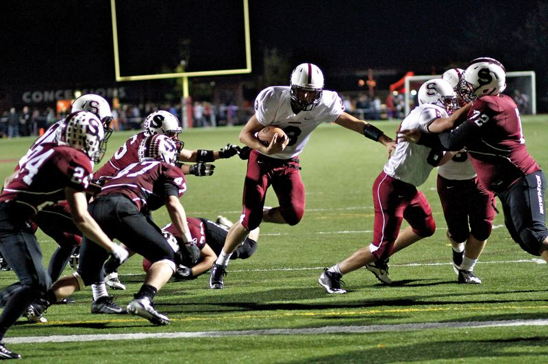 by: CONTRIBUTED PHOTO: JULI CHURCHILL - Sandy quarterback Justin Adams rushed for five touchdowns and passed for one in an 84-42 loss to the Sherwood Bowmen last Friday.