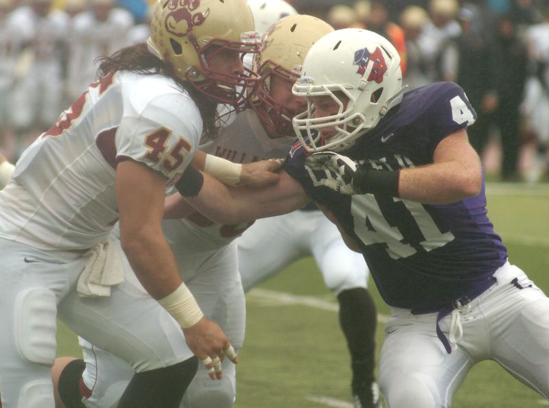 by: PAMPLIN MEDIA GROUP: DAVID BALL - Linfield lineman Brynnan Hyland works to get past Willamettes Benny Weishedel during the Wildcats 45-10 win Saturday. Hyland dropped Willamette ball carries behind the line of scrimmage seven times on the day.