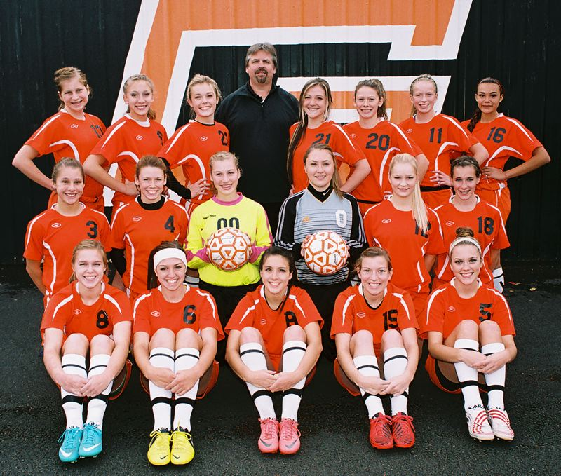 by: JOHN DENNY - Gladstone High Schools girls soccer team has accomplished a rare feat this fall, winning their fourth straight league title. Members of the standout team include: (front, from left) seniors Madi Cronin, Taylor Plunkett, Amber Jensen, Victoria Finley and Grace Kersting; (second row) juniors Kelsey Hathaway and Kendall Schumaker, sophomores Gabrielle Wachlin and Molly Webster, junior Nanna Sandholt and freshman Allie Seymour; and (back) sophomores Tianna Smith, Mikaela Simac and Riley Webster, coach Steve Thomas, juniors Cheyenne Stubblefield and Julia Schumaker, and sophomores Chelsea Entrambasaguas and Talia Pena.