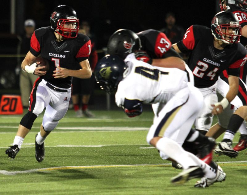 by: JONATHAN HOUSE - Clackamas running back Dan Sherrell picks up a block from Brody Haehlen as he rambles for yardage in Fridays game with Canby.
