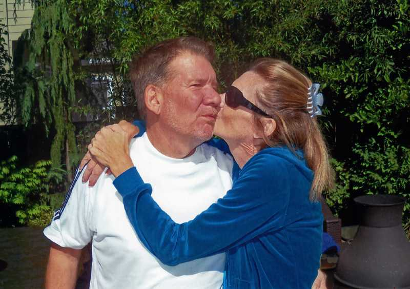 by: SUBMITTED PHOTO - Vicky Kelly gives a big smooch of gratitude to her brother, Gary Petersen. He saved her life by donating a kidney.