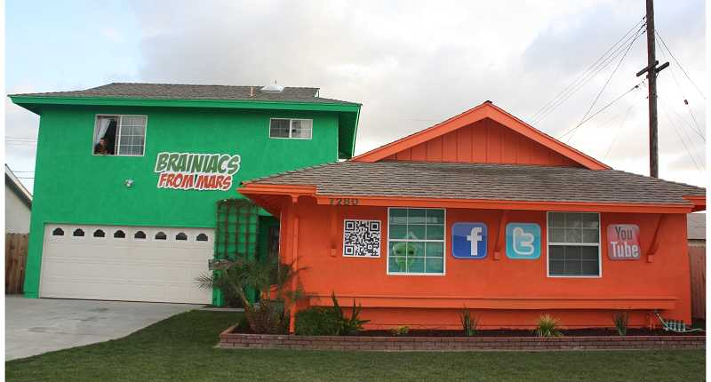 by: SUBMITTED PHOTO - This Buena Park, Calif., home was painted neon for two months in February.