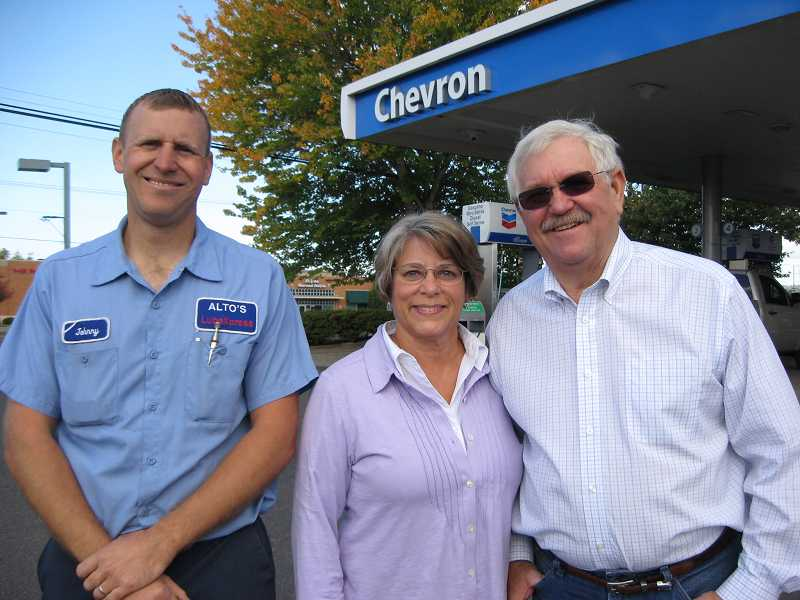 by: RAY PITZ - END OF AN ERA - Johnny, Dorothy and John Alto stand outside the business they've run for almost four decades.