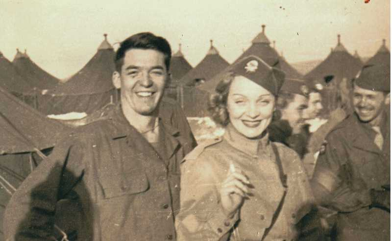 by: COURTESY OF DICK BERNHARD - MARLENE AND ME - Lucky Dick Bernhard was chosen to escort movie actress and singer Marlene Dietrich around the camp of C Company of the 508th Parachute Infantry Regiment of the 82nd Airborne Division when she made a visit; she was a high-profile frontline entertainer during World War II.
