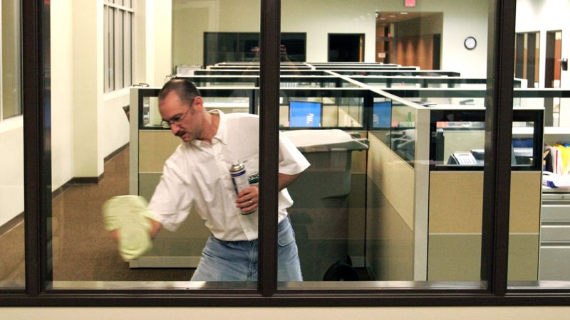 by: OUTLOOK PHOTO: JIM CLARK - Jeff Gilbert, ex-principal of Reynolds High School, cleans office windows on Oct. 5 at his job as a night janitor at Bennu Glass in Kalama, Wash. After being fired from his job as principal of Reynolds High School, Gilbert retained an attorney and has been fighting to restore his reputation.  OUTLOOK PHOTOs: JIM CLARK