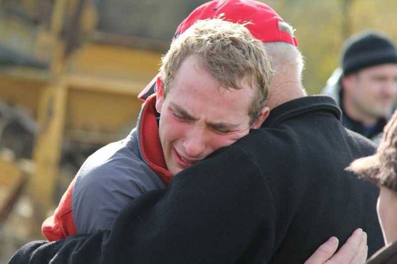 by: RYAN WARNICK  - Jackson Chandler, 17, shares a moment at base camp. The teen and his hiking partner, Bradley Nelson, 16, had a heartfelt reunion with friends and family Monday afternoon.