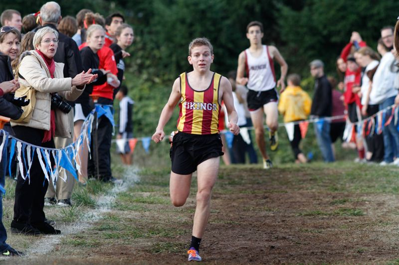 by: CHASE ALLGOOD - Forest Grove senior Seth Berdahl pushes for the finish line durin the Pacifc Conference cross country meet at Clackamas Community College.