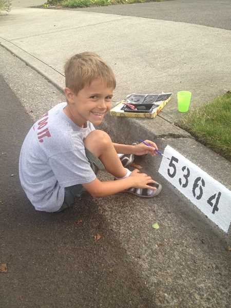 by: SUBMITTED PHOTO: REGIS LABORIE - Knowing Oak Creek Elementary needed to raise funds for special enrichment programs at the school, third-grader Lucas Laborie spent a weekend painting house numbers on the curbs in front of 20 of his neighbors' houses. His efforts raised $150 to support the programs.